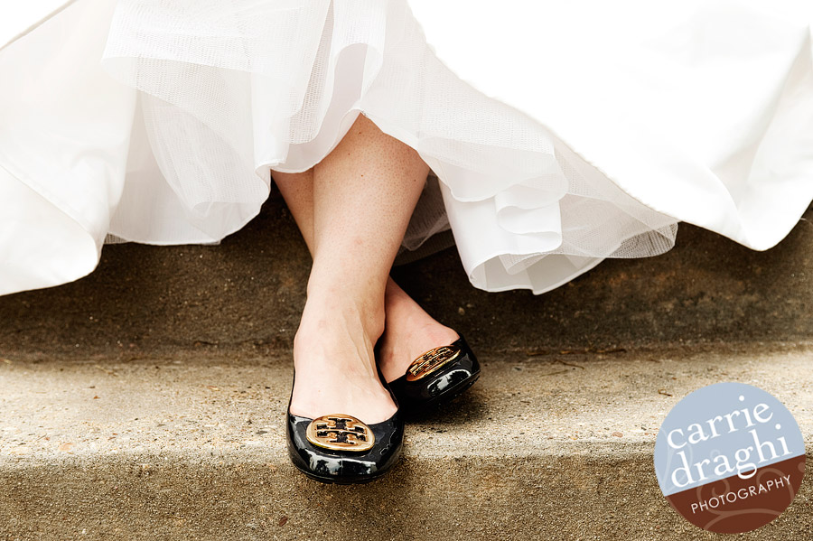 bride's shoes under dress