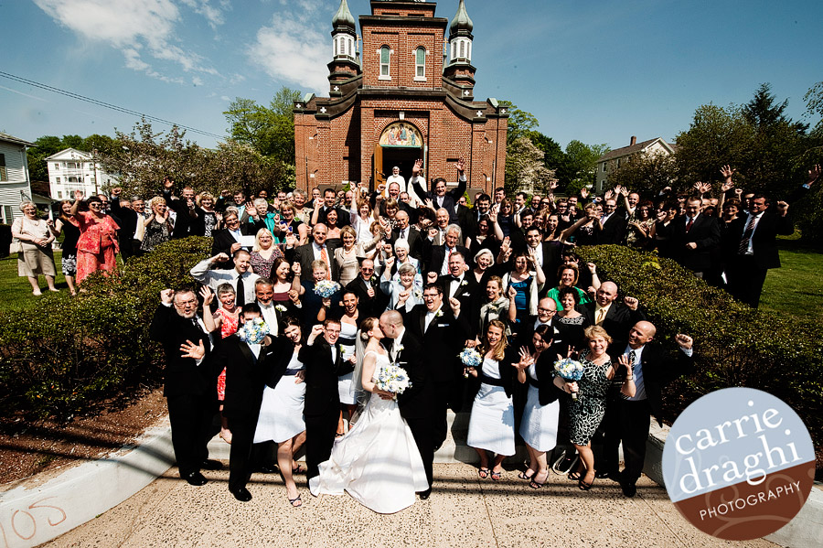 group photo of wedding guests outside of church