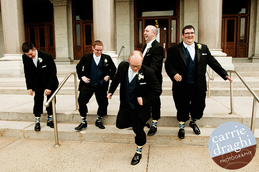 Groomsmen dancing an Irish Jig