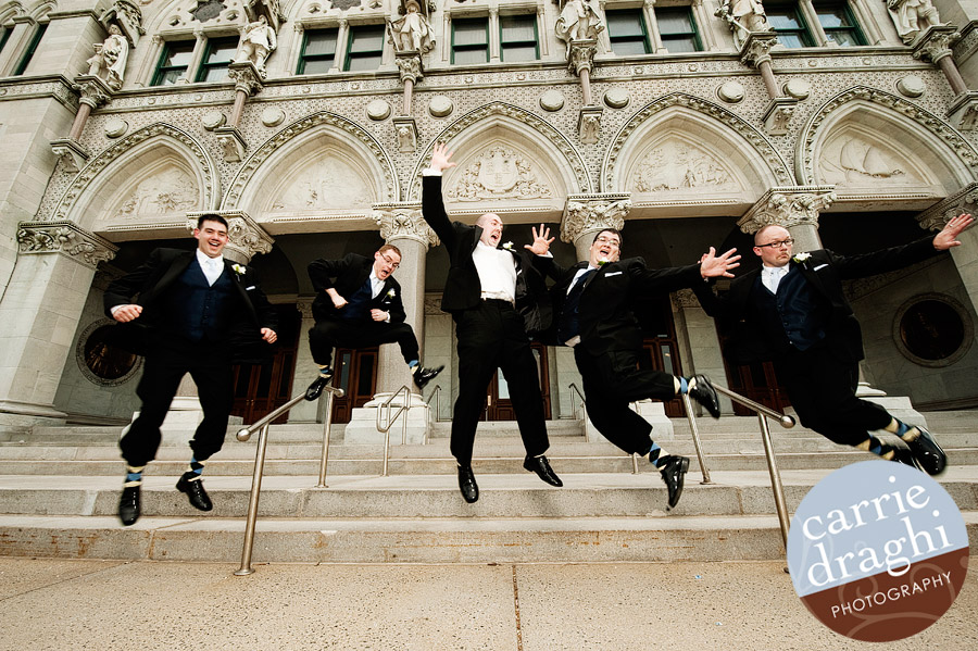 Groomsmen jumping at CT State Capitol
