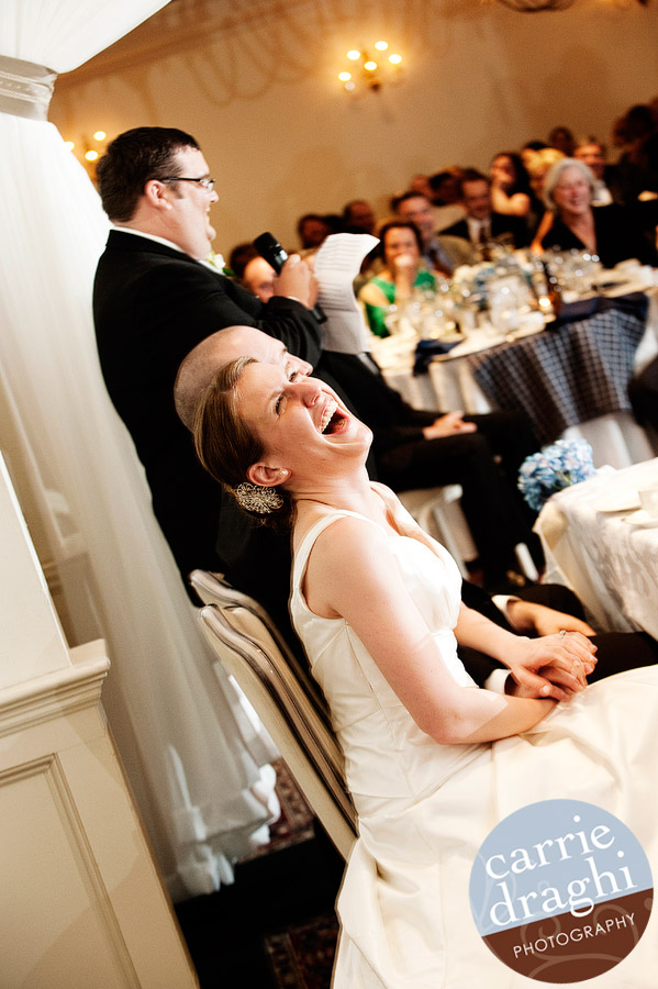 Bride laughing during wedding toast at Simsbury Inn