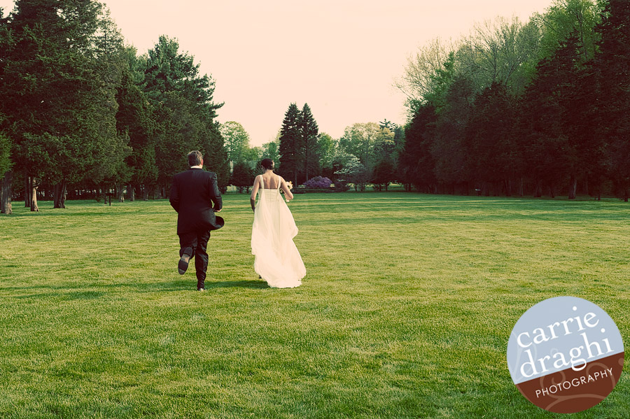 Bride and groom running on Wadsworth Mansion lawn